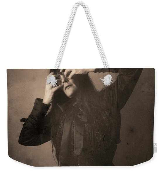 Weekender Tote Bag featuring the photograph Madness Number 1 by Clayton Bastiani