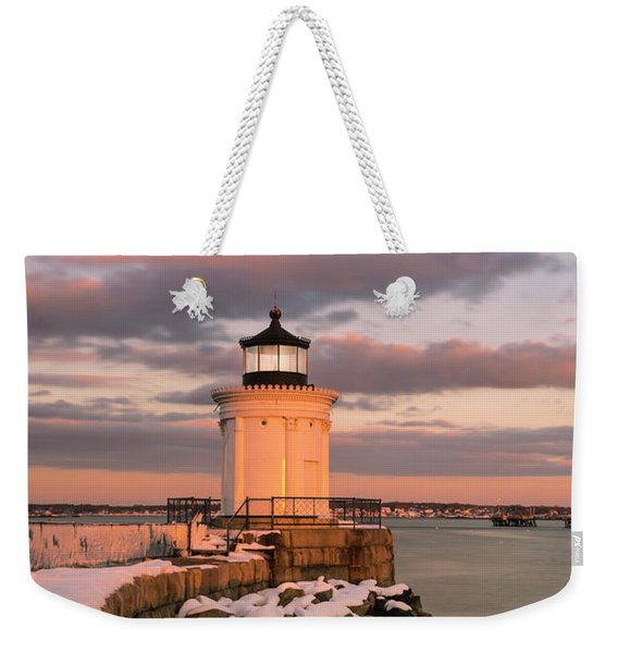 Weekender Tote Bag featuring the photograph Maine Bug Light Lighthouse Snow At Sunset by Ranjay Mitra