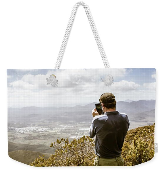 Male Tourist Taking Photo On Mountain Top Weekender Tote Bag