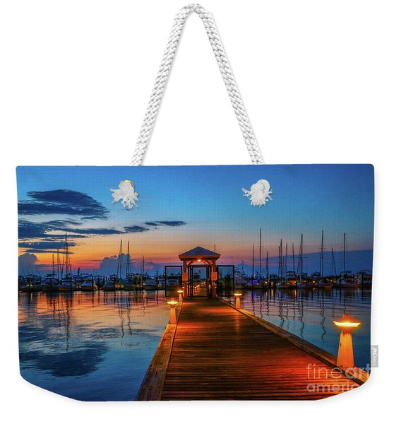 Weekender Tote Bag featuring the photograph Marina Sunrise by Tom Claud