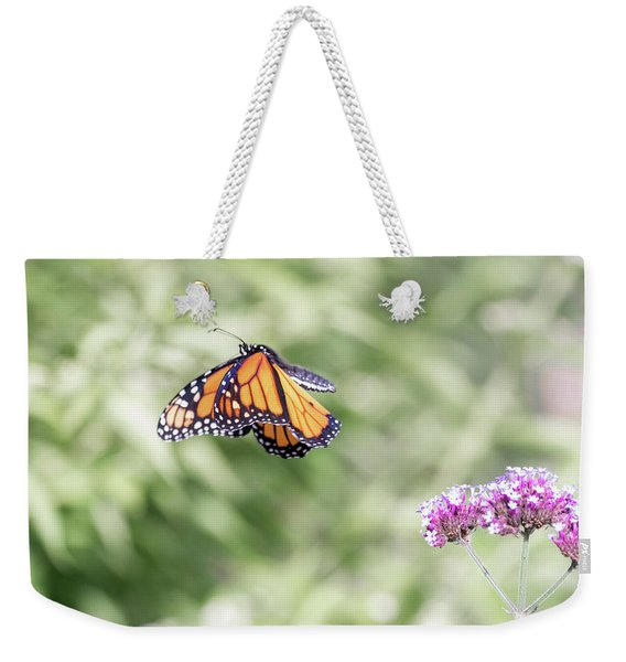 Weekender Tote Bag featuring the photograph Mid-air Monarch 1 by Brian Hale