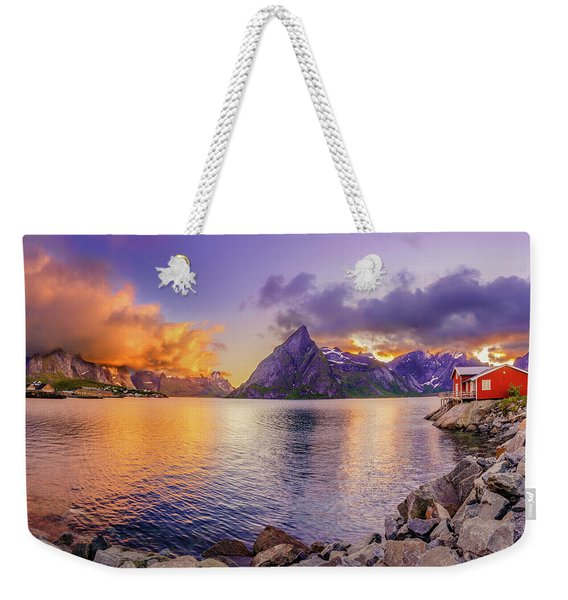 Weekender Tote Bag featuring the photograph Midnight Orange by Dmytro Korol