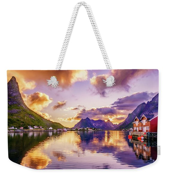 Weekender Tote Bag featuring the photograph Midnight Sun Reflections In Reine by Dmytro Korol