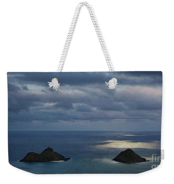 Weekender Tote Bag featuring the photograph Moonlight Over Mokulua Islands by Charmian Vistaunet