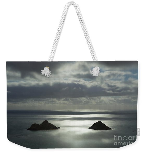 Weekender Tote Bag featuring the photograph Moonlit Mokulua Islands by Charmian Vistaunet