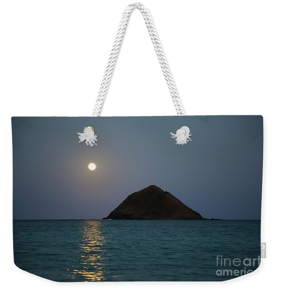 Weekender Tote Bag featuring the photograph Moonrise Over Moku Iki by Charmian Vistaunet