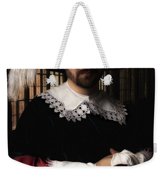 Weekender Tote Bag featuring the photograph Musketeer In The Old Castle Hall by Jaroslaw Blaminsky