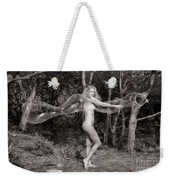 Weekender Tote Bag featuring the photograph Nude Woman And Giant Bubble by Clayton Bastiani