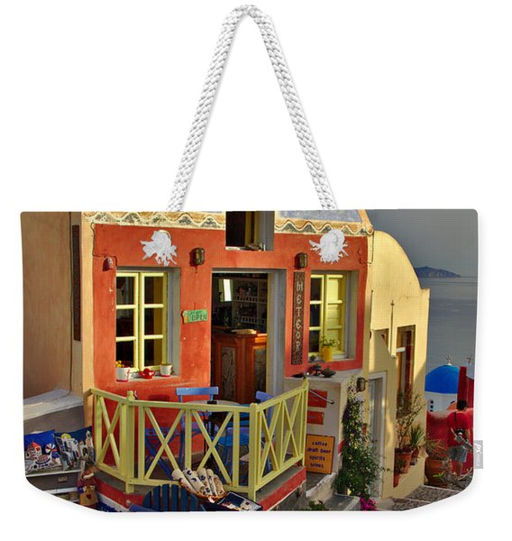 Weekender Tote Bag featuring the photograph Oia Pub by Jeremy Hayden