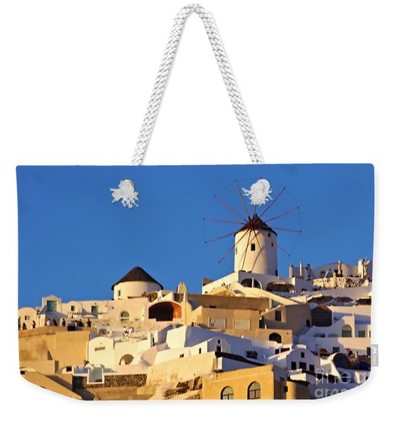 Weekender Tote Bag featuring the photograph Oia Windmill by Jeremy Hayden
