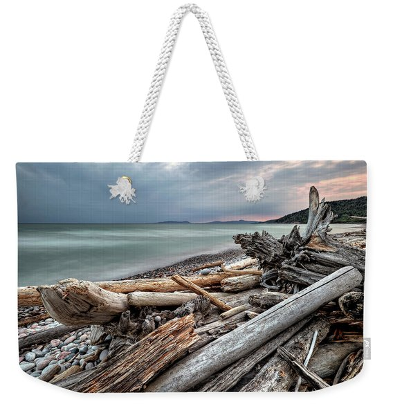 Weekender Tote Bag featuring the photograph On The Beach by Doug Gibbons