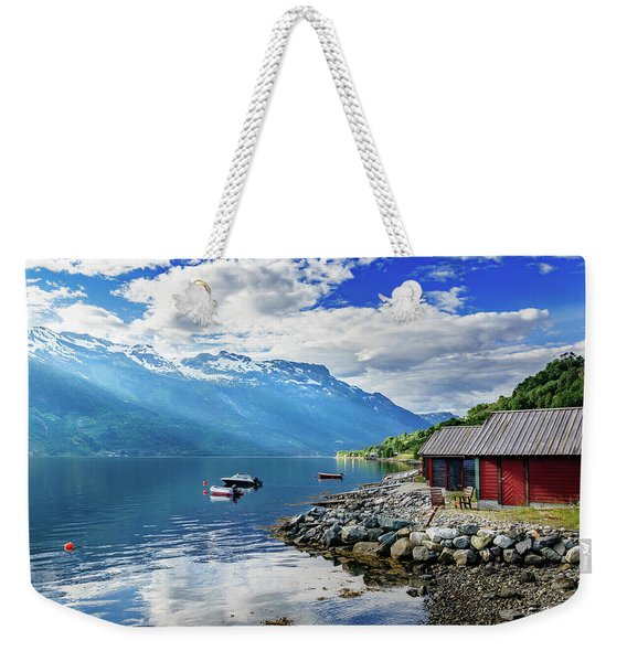 Weekender Tote Bag featuring the photograph On The Beach Of Sorfjorden by Dmytro Korol