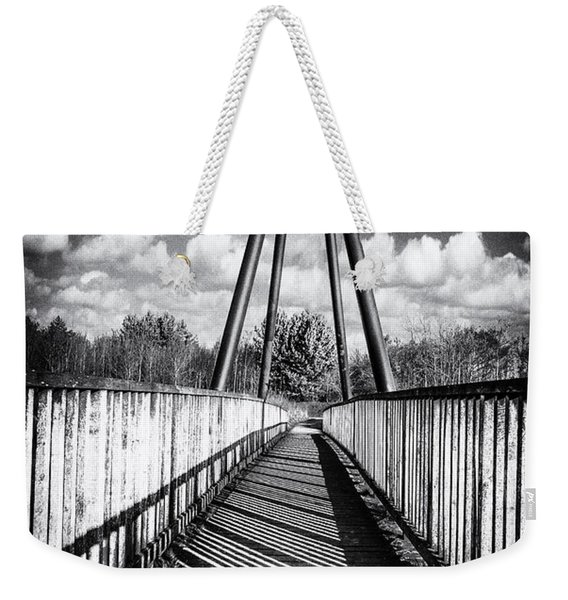 Weekender Tote Bag featuring the photograph Over And Under by Nick Bywater