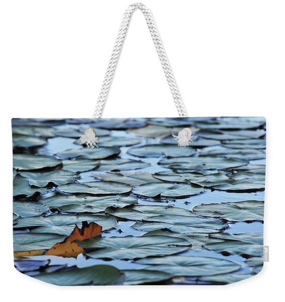 Weekender Tote Bag featuring the photograph Pads by Scott Cordell