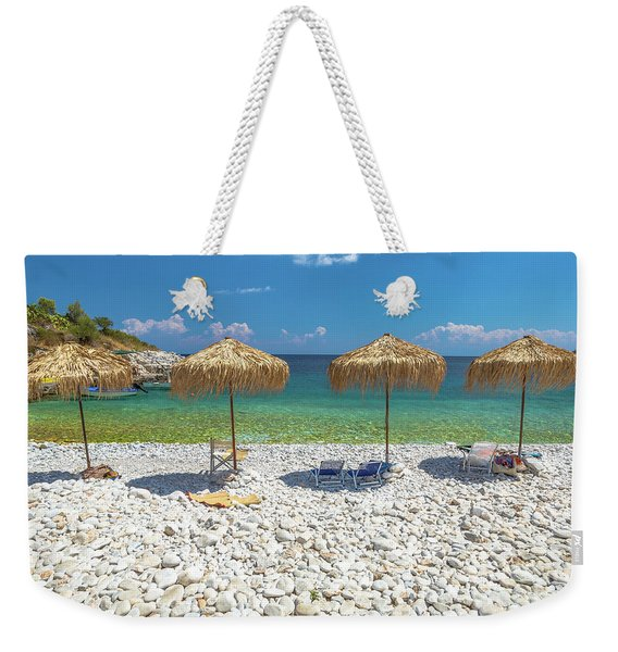 Weekender Tote Bag featuring the photograph Palapa Umbrellas by Benny Marty