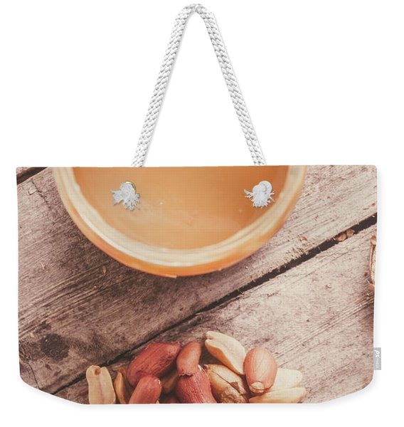 Peanut Butter Jar With Peanuts On Wooden Surface Weekender Tote Bag