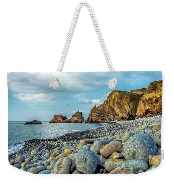 Weekender Tote Bag featuring the photograph Pebbles On The Beach by Nick Bywater