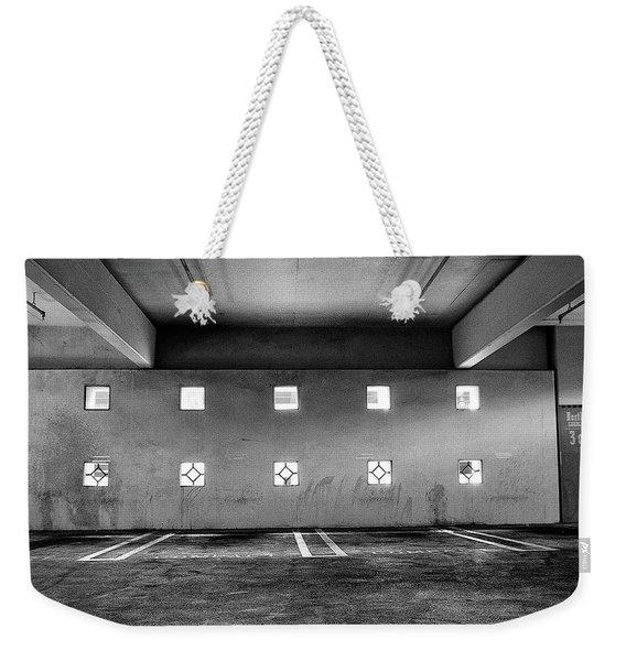 Peep Holes Wall In Parking Structure Weekender Tote Bag