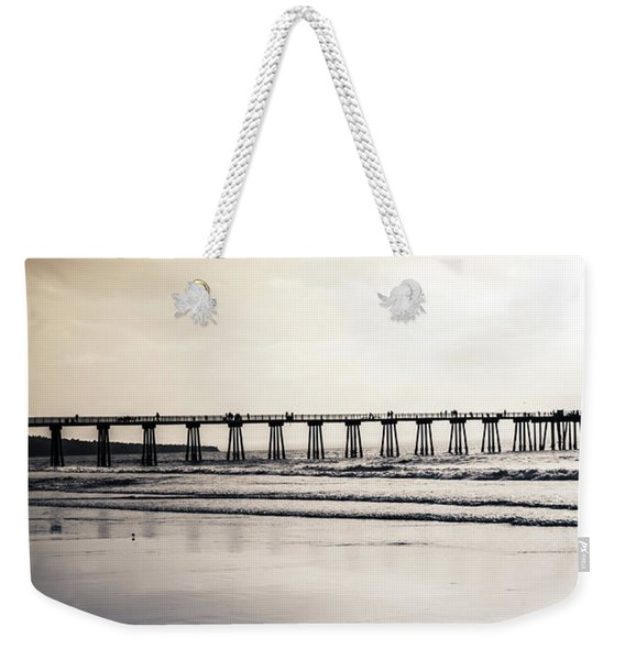 Weekender Tote Bag featuring the photograph Pier On Duotone by Michael Hope
