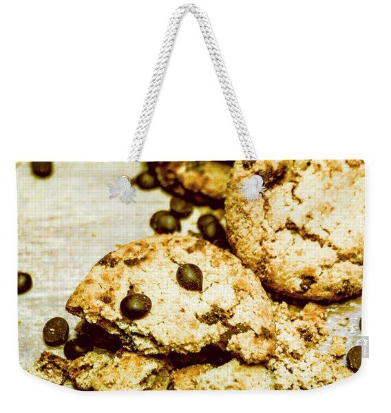 Pile Of Crumbled Chocolate Chip Cookies On Table Weekender Tote Bag