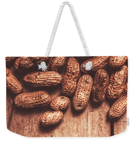 Pile Of Peanuts Covering Top Half Of Board Weekender Tote Bag