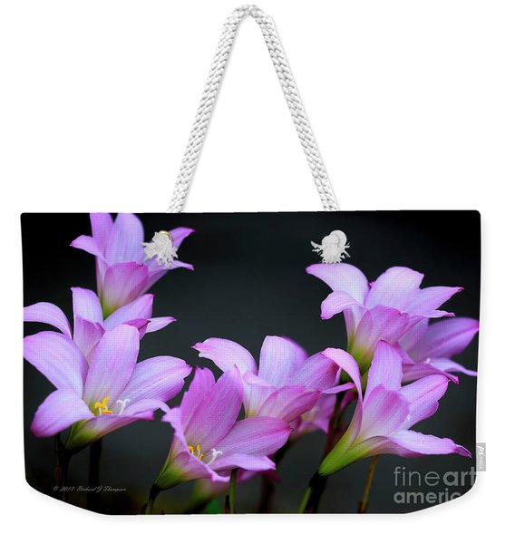 Weekender Tote Bag featuring the photograph Pink Fairy Lilies by Richard J Thompson