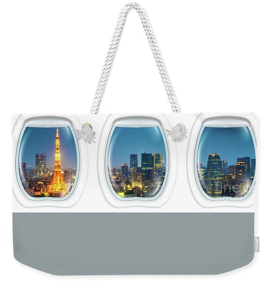 Weekender Tote Bag featuring the photograph Porthole Frame On Tokyo Tower by Benny Marty