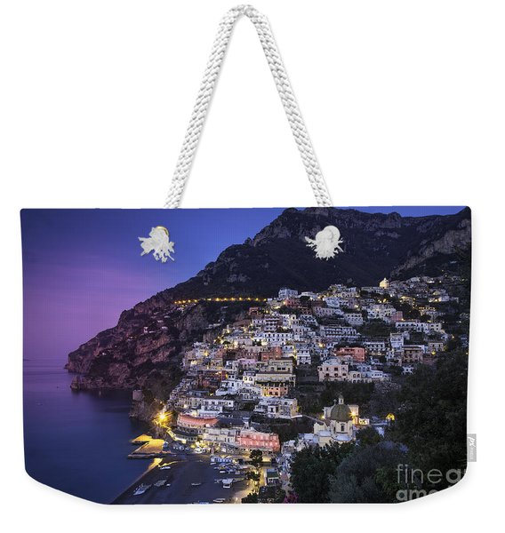 Weekender Tote Bag featuring the photograph Positano Twilight by Brian Jannsen