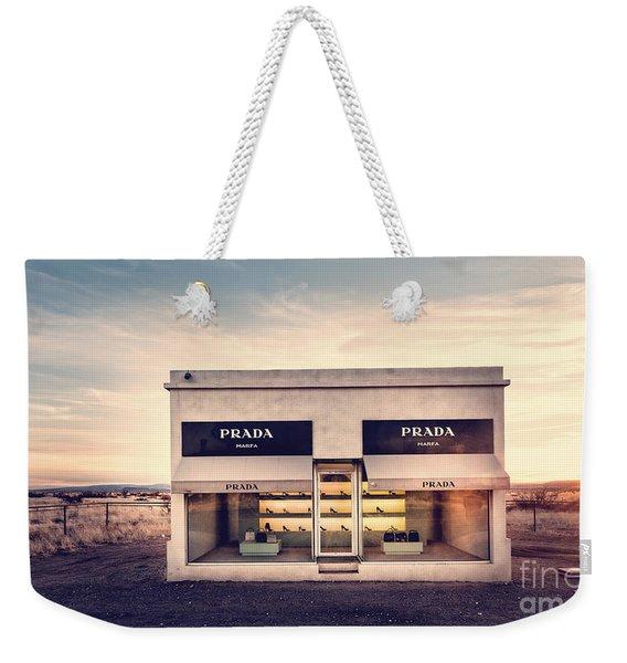 Weekender Tote Bag featuring the photograph Prada Store by Prada