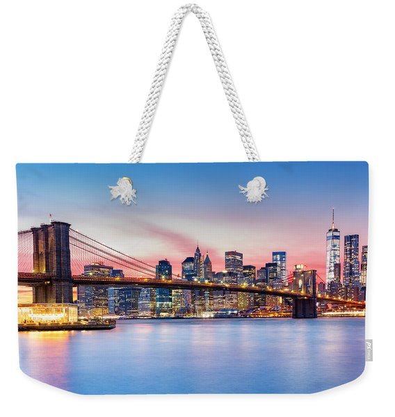 Weekender Tote Bag featuring the photograph Purple Nyc Sunset by Mihai Andritoiu