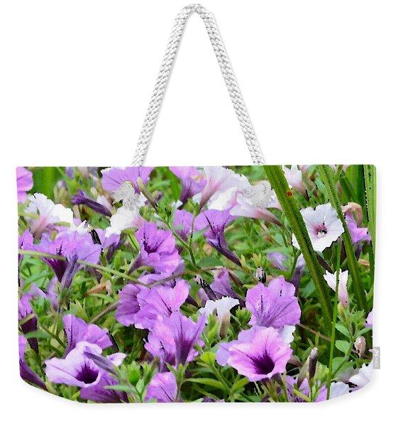 Weekender Tote Bag featuring the photograph Purple Petunias by Kim Bemis