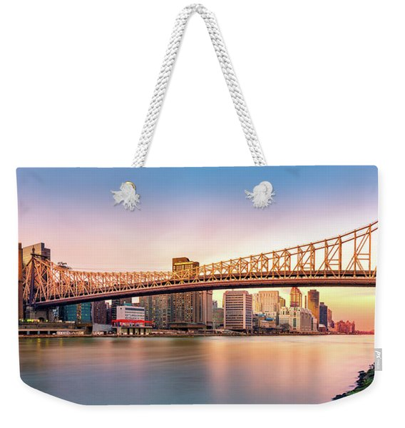 Weekender Tote Bag featuring the photograph Queensboro Bridge At Sunset by Mihai Andritoiu