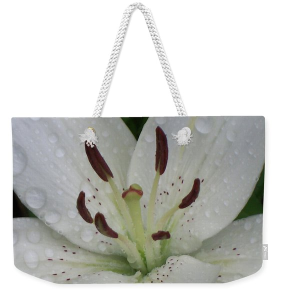 Weekender Tote Bag featuring the photograph Rain Drops On Lily by Cris Fulton