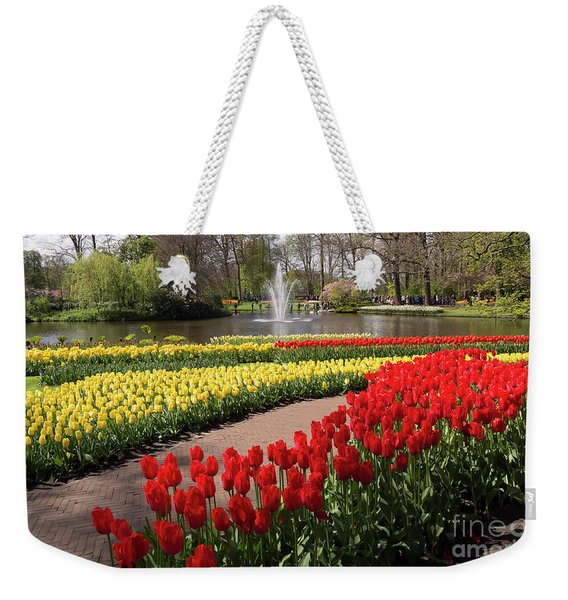 Red And Yellow Tulips On The River Bank In Keukenhof Gardens Weekender Tote Bag