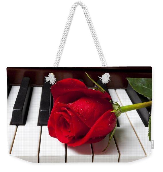 Red Rose On Piano Keys Weekender Tote Bag