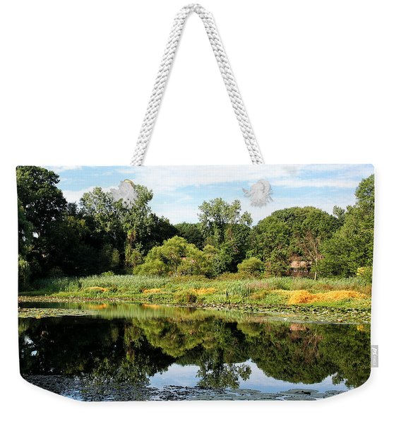 Weekender Tote Bag featuring the photograph Reflecting On A Summer Morning by William Selander