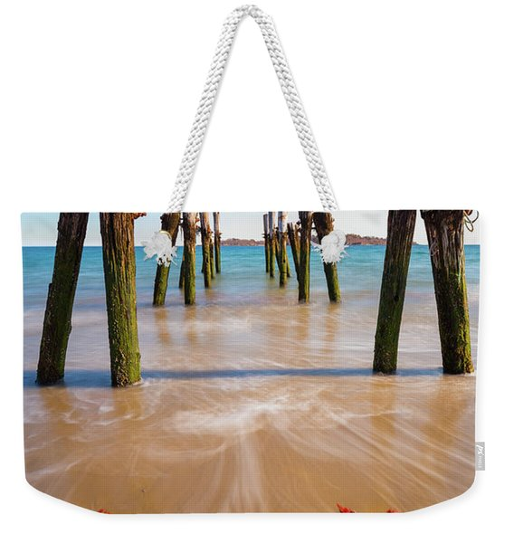 Weekender Tote Bag featuring the photograph Returning To The Ocean by Brian Hale