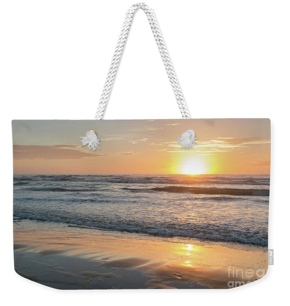 Rising Sun Reflecting On Wet Sand With Calm Ocean Waves In The B Weekender Tote Bag