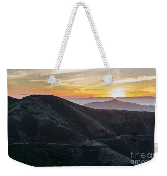 Road On The Edge Of The Mountain With Sunrise In The Background Weekender Tote Bag