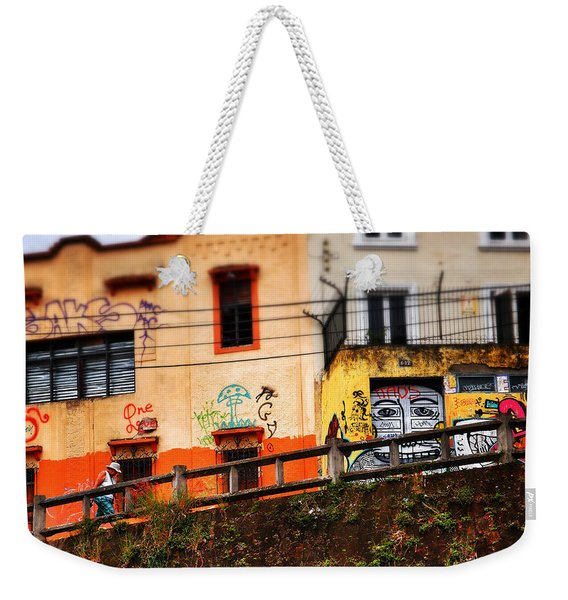 Weekender Tote Bag featuring the photograph Saks by Skip Hunt