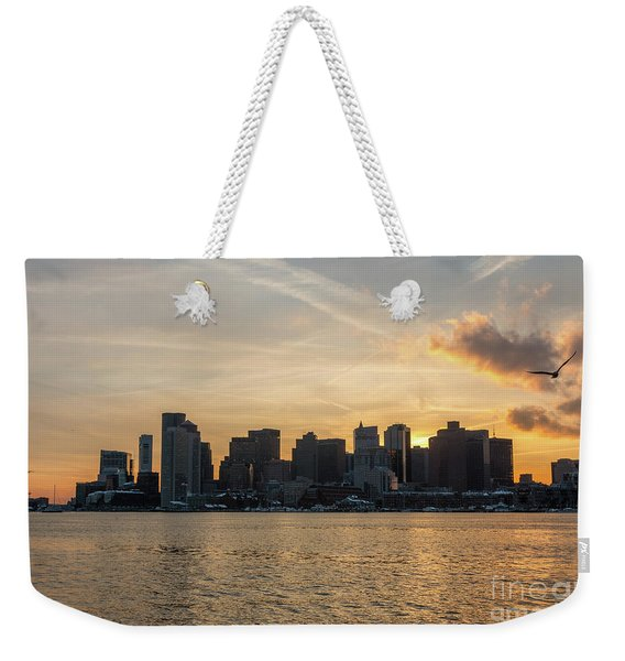 Seagull Flying At Sunset With The Skyline Of Boston On The Backg Weekender Tote Bag