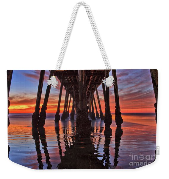 Weekender Tote Bag featuring the photograph Seaside Reflections Under The Imperial Beach Pier by Sam Antonio Photography