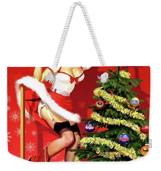 Sexy Pin-up Blond Is Decorating A Christmas Tree Weekender Tote Bag