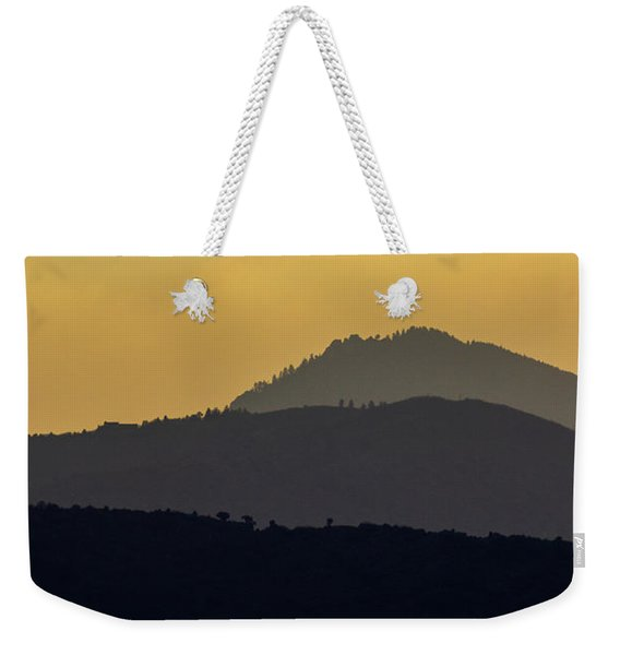 Weekender Tote Bag featuring the photograph Silhouettes by John De Bord