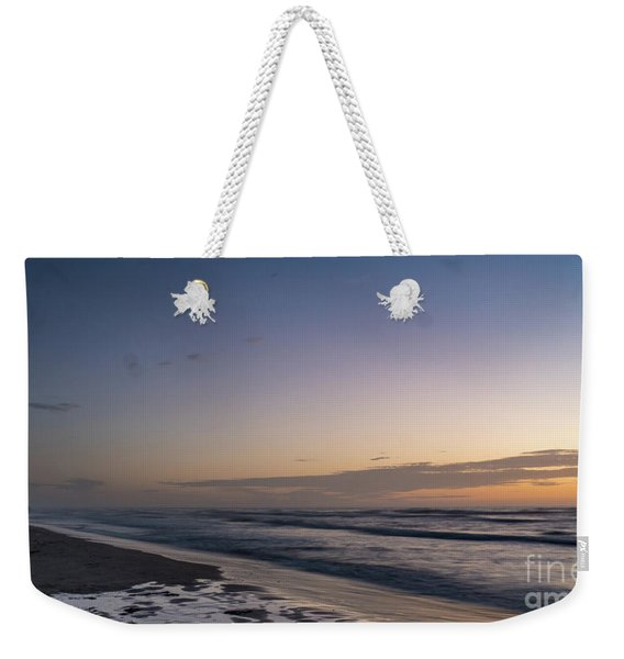 Single Man Walking On Beach With Sunset In The Background Weekender Tote Bag