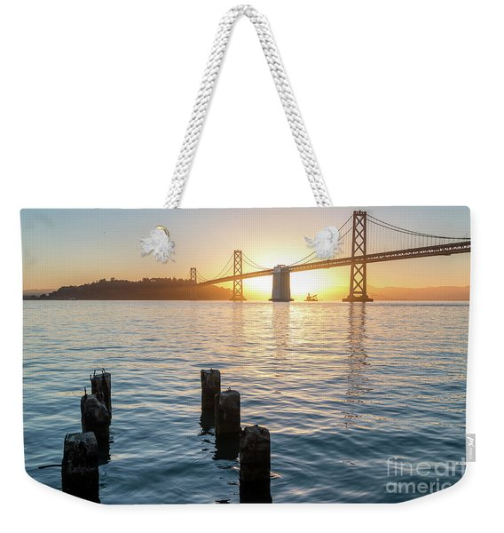 Six Pillars Sticking Out The Water With Bay Bridge In The Backgr Weekender Tote Bag