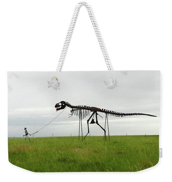 Skeletal Man Walking His Dinosaur Statue Weekender Tote Bag