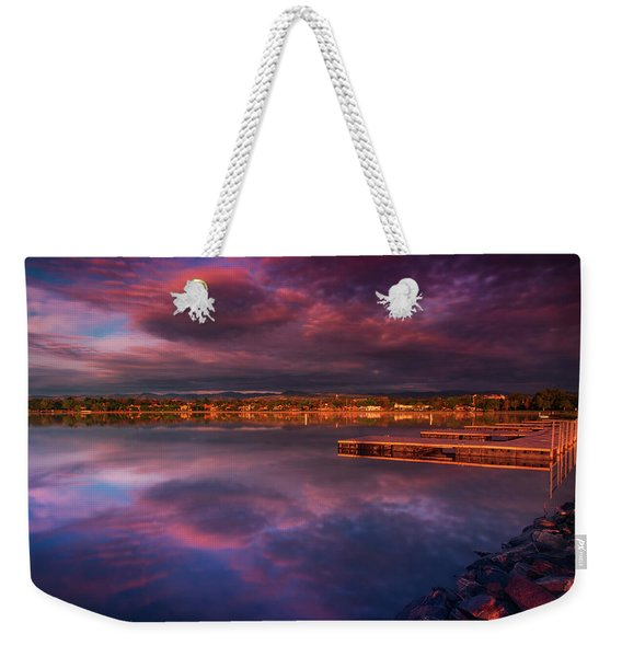 Weekender Tote Bag featuring the photograph Skies Of Golden Hour by John De Bord