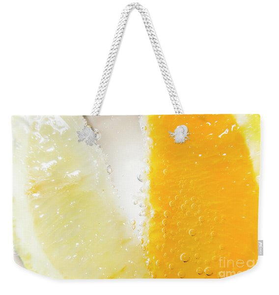 Slice Of Orange And Lemon In Cocktail Glass Weekender Tote Bag