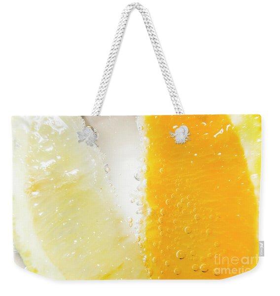 Slice Of Orange And Lemon In Cocktail Glass Weekender Tote Bag